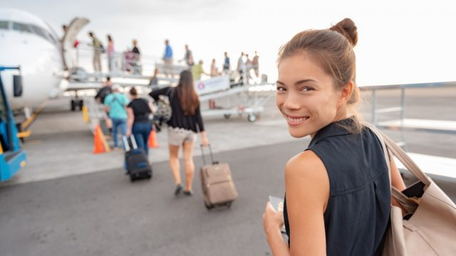 travel-woman-boarding-airplane-airport-happy-young-asian-lady-tourist-walking-outside-tarmac-leaving-vacation-trip-156593573.jpg