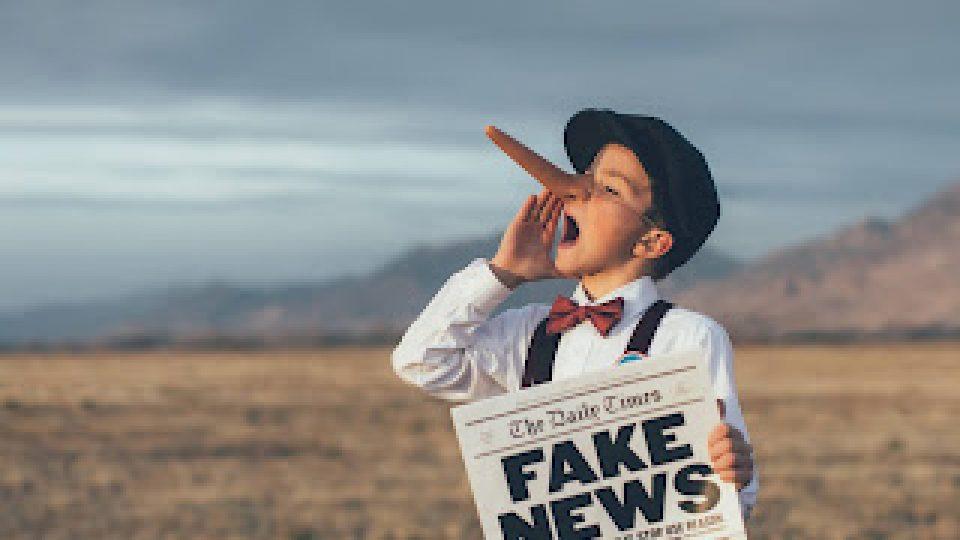 ey-boy-holding-newspaper.jpg