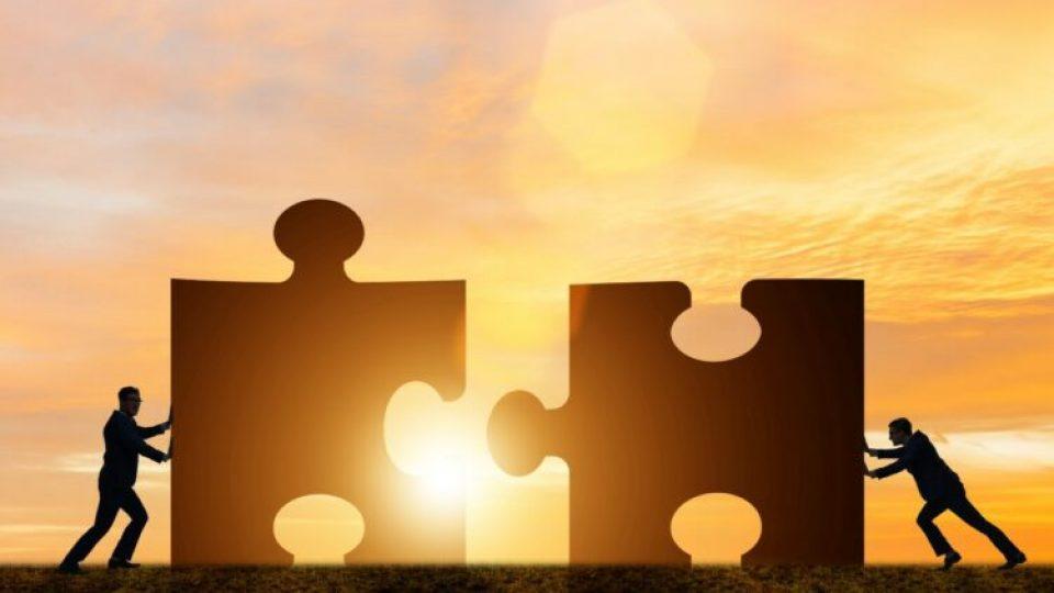 espa-business-concept-teamwork-with-jigsaw-puzzle-750x500-1.jpg